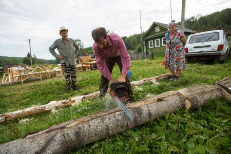 ecovillage: SOGINITSY, RUSSIA - JULY 25, 2014: Unidentified participants during folk festival Ivan-Tea (lat. Chamaenerion) from ecovillage Grishino. Editorial