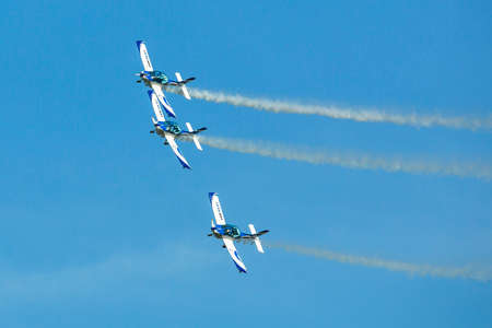 may fly: BERLIN, GERMANY - MAY 21, 2014: Aerobatic team 3x Fly Sinthesis Texan Top Class (Wefly team, Italy) demonstration during the International Aerospace Exhibition ILA Berlin Air Show-2014.