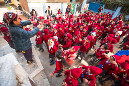 schoolroom: KATHMANDU, NEPAL - DEC 22, 2013: Unknown pupils during dance lesson in primary school. Only only 25% of girls attend schools and half of the children can reach the 5 grade. Editorial