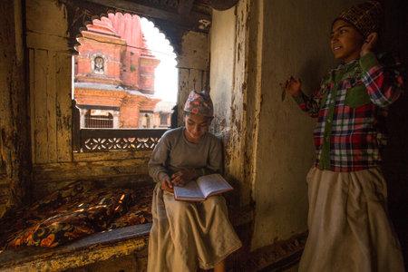 sanskrit: KATHMANDU, NEPAL - DEC 9, 2013: Unknown children doing homework at Jagadguru School. School established at 2013, to let new generation learn Sanskrit and preserve Hindu culture.