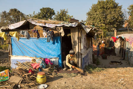 slums: KATHMANDU, NEPAL - DEC 16, 2013: Unidentified poor people near their houses at slums in Tripureshwor district. Caste of untouchables in Nepal, is about 7 % of population.