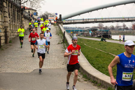 conducted: KRAKOW, POLAND - MAR 23, 2014: Unidentified participants during the annual Krakow international Marathon. Krakow Marathon conducted since 2002 under the slogan: With history in the background. Editorial