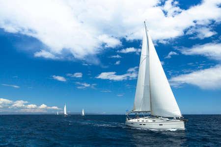 sailboat race: Sailboats participate in sailing regatta. Luxury Yachts. Stock Photo
