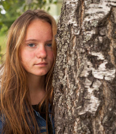 european white birch: Pretty young girl in the birch forest. Stock Photo