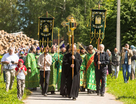 rev: KRASNY BRONEVIK, RUSSIA - JULY 7, 2014: Celebrations commemorating the Rev. Anthony Dymsky (died 1224) in Antony Dymsky Monastery - Procession on Lake Dymsky, the great blessing of water and bathing.