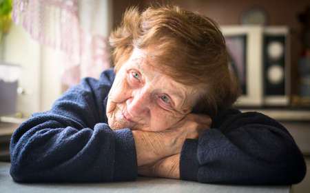 Portrait of old woman in her home. photo