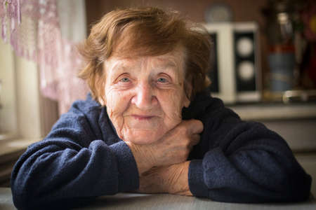 residental care: Close-up portrait of an happy old woman Stock Photo