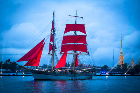 salut: ST.PETERSBURG, RUSSIA - JUN 20, 2014: The frigate participated in festivities marks school graduations. In 2014, the festival Scarlet Sails celebrates its tenth anniversary. Editorial