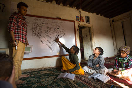 KATHMANDU, NEPAL - DEC 9, 2013: Unknown children in lesson at Jagadguru School. School established at 2013, to let new generation learn Sanskrit and preserve Hindu culture.