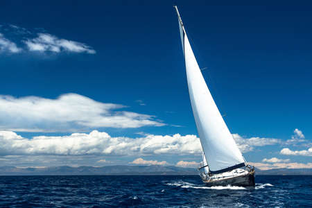 Sailing at ocean. Romantic trip luxury yacht. photo