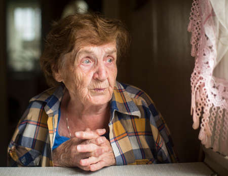 Portrait of a lonely old woman. Caring for the Elderly.