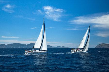 sailboat race: METHANA - POROS - ERMIONI, GREECE - MAY 4, 2014: Unidentified sailboats participate in sailing regatta 11th Ellada Spring 2014 on Aegean Sea. Editorial
