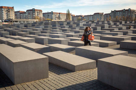 murdered: BERLIN, GERMANY - NOV 17, 2014: Memorial to the Murdered Jews of Europe, designed by architect Peter Eisenman and engineer Buro Happold, site 19,000 m2 covered with 2,711 concrete slabs.