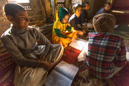 sanskrit: KATHMANDU, NEPAL - DEC 9, 2013: Unknown students in lesson at Jagadguru School. School established at 2013, to let new generation learn Sanskrit and preserve Hindu culture.