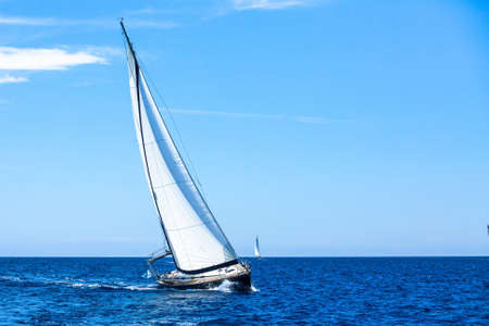 sailboat race: Sailing. Sailboat participate in sailing regatta. Luxury yachts. Stock Photo