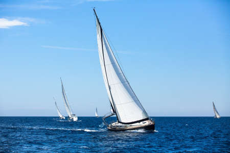 poros: Group of sail yachts in regatta in open the Sea. Boat in sailing regatta. Luxury yachts.