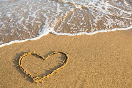 Heart drawn on the sand of a beach.