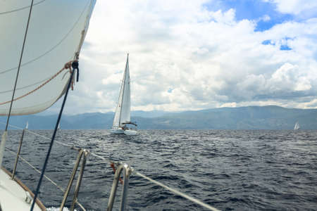 stormy sea: Sailing yacht on the race in a stormy sea.
