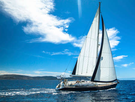sailboat race: Sailing in the wind through the waves. Sailing. Luxury yachts. Stock Photo