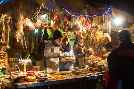KRAKOW, POLAND - DEC 31, 2014: Holiday trading on the Main Market Square in Krakow during the celebration of the inhabitants of the New Year.