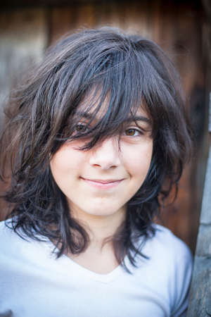 disheveled: Portrait of a teenage girl with disheveled black hair.