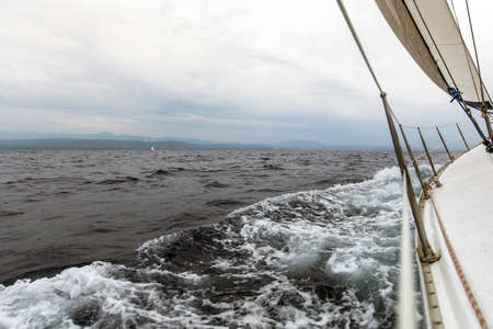 yachting: Sailing in cloudy weather. Yachting. Luxury yachts.