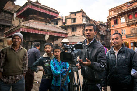 nepali: BHAKTAPUR, NEPAL - DEC 7, 2013: Unidentified employees Nepali TV shoot a report about potters from Bhaktapur. Nepali TV, which was created in 1985 as a state broadcasting organization, has 19 transmitting stations.