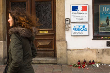 consulate: KRAKOW, POLAND - JAN 11, 2015: Action near the facade of the Consulate General of France in Krakow solidarity for the victims of the Charlie Hebdo attacks in Paris.