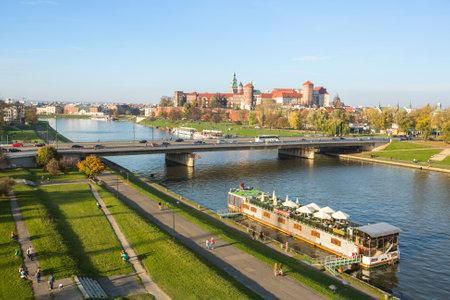 polska monument: KRAKOW, POLAND - OCT 20, 2013: View of the Vistula River in the historic city center. Vistula is the longest river in Poland, at 1,047 kilometres in length.