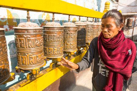 stupa one: KATHMANDU, NEPAL - DEC 11, 2013: Unidentified old woman near stupa Boudhanath. Stupa is one of the largest in the world, of 1979 is a UNESCO World Heritage Site.