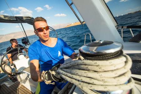 ellada: GALAXIDI, GREECE - SEP 29, 2014: Unidentified sailors participate in sailing regatta 12th Ellada Autumn 2014 on Aegean Sea. Editorial