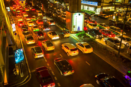 worse: BANGKOK, THAILAND - DEC 18, 2014: Traffic jam in city centre at night. Bangkoks traffic problem getting worse, since government in 2012 y. introduced a policy to refund tax for first-time car buyers.