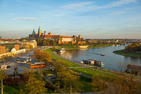 polska monument: KRAKOW, POLAND - OCT 20, 2013: View of Royal Wawel castle and Vistula River. The monument to the history of the Decree of the President Lech Walesa on Sep 8, 1994.