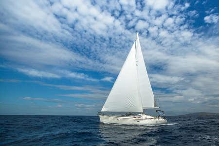 boat: Cruising on a sailing boat. Boat in sailing regatta. Luxury yachts.