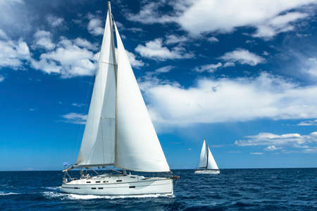 ships at sea: Sailboats participate in sailing regatta. Sailing. Yachting. Luxury Yachts.