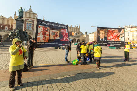 abortion: KRAKOW, POLAND - FEB 7, 2015: Unidentified participants protests against abortion on Main Market Square near Church of Our Lady Assumed into Heaven (also known as St. Marys Church)
