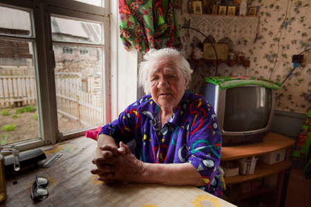 reg: VINNITSY, RUSSIA - CIRCA MAY, 2012: Unidentified old woman Veps - small Finno-Ugric people living on territory of Leningrad region in Russia. Total number in Leningrad reg.- 1380 people (to 2010 year) Editorial
