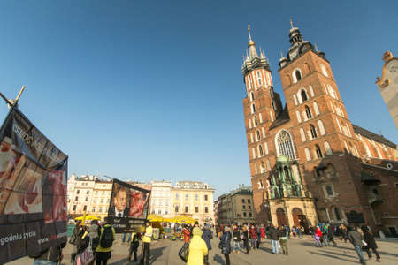 assumed: KRAKOW, POLAND - FEB 7, 2015: Unidentified participants protests against abortion on Main Market Square near Church of Our Lady Assumed into Heaven (also known as St. Marys Church)