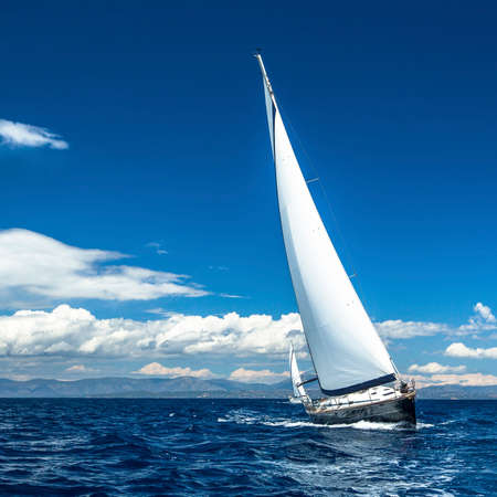 sailing ship: Yacht sails with beautiful cloudless sky. Sailing. Luxury yacht. Stock Photo