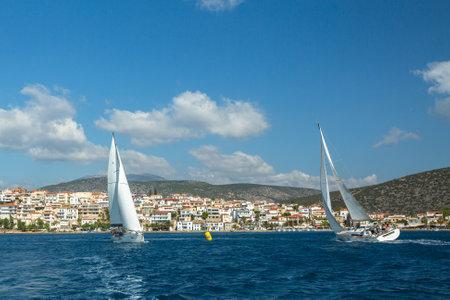 ellada: HYDRA, GREECE - CIRCA OCT, 2014: Unidentified sailboats participate in sailing regatta 12th Ellada Autumn 2014 among Greek island group in the Aegean Sea, in Cyclades and Argo-Saronic Gulf.