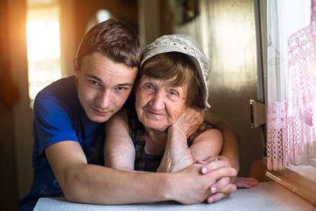grandmother: Grandson hugging her grandmother posing for a portrait.