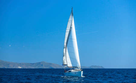 luxery: Sailing ship yachts with white sails. Luxery sailing yacht.