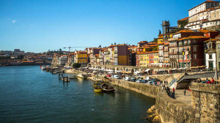 recognised: PORTO, PORTUGAL - FEB 17, 2015: Ribeira, traditional boats at Douro river in Old Town. In 1996, UNESCO recognised Old Town of Porto as a World Heritage Site.