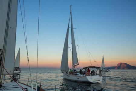 ellada: PATRAS, GREECE - CIRCA OCT, 2014: Unidentified sailboats participate in sailing regatta 12th Ellada Autumn 2014 among Greek island group in the Aegean Sea, in Cyclades and Argo-Saronic Gulf.
