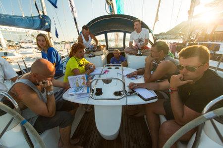 ellada: PATRAS, GREECE - CIRCA OCT, 2014: Unidentified sailors on skippers briefing in the yacht wardroom during sailing regatta 12th Ellada Autumn 2014 among Greek island. Editorial
