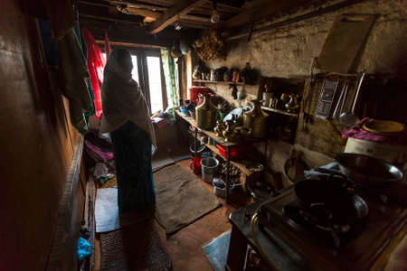 rigid: BHAKTAPUR, NEPAL - CIRCA DEC, 2013: Unidentified poor people in his house. The caste system is still intact today but the rules are not as rigid as they were in the past.