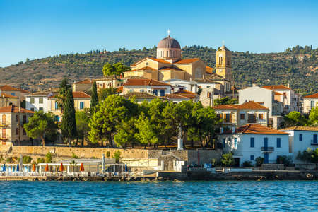 ortodox: View from the sea of buildings and Ortodox temple of a Greek harbor Galaxidi in Greece.
