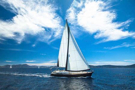 yachting: Luxury boat traveling on sea. Sailing. Yachting. Stock Photo