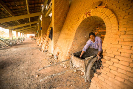 categorized: BHAKTAPUR, NEPAL - CIRCA DEC, 2013: Unidentified local people work at the Brick Factory. Nepal as a whole has been categorized as the 4th most vulnerable country in the world due to climate change.