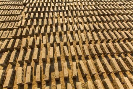 deprived: BHAKTAPUR, NEPAL - CIRCA DEC, 2013: On-site local Brick Factory. A survey found 74 kilns in the Bhaktapur district of KTM. In Kathmandu, respiratory problems occur at 12 times the national average.